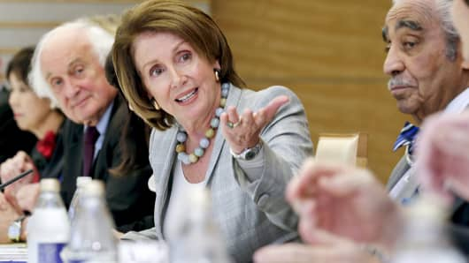 House Minority Leader Nancy Pelosi introduces House members during the talks with Japanese Prime Minister Shinzo Abe in Tokyo on April 3, 2015.