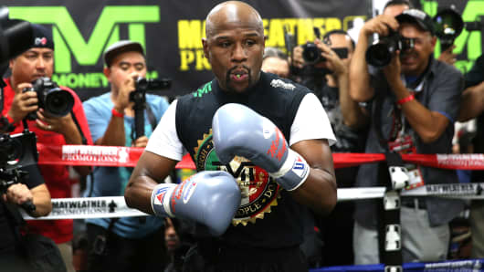 WBC/WBA welterweight champion Floyd Mayweather loosens up before he works out at the Mayweather Boxing Club on April 14, 2015 in Las Vegas.