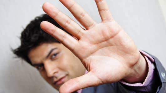 Man gesturing stop