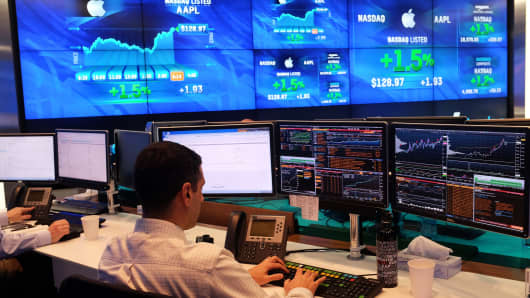 A trader works at the Nasdaq MarketSite in New York