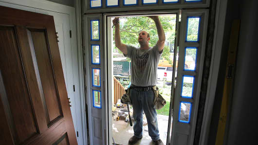 A home improvement contractor works on a house in Cambridge, Massachusetts.