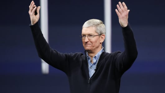 Apple CEO Tim Cook gestures on stage during an Apple special event in San Francisco, California