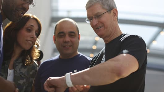 Apple CEO Tim Cook displays his personal Apple Watch to customers at an Apple Store on April 10, 2015 in Palo Alto, California.