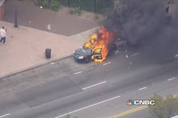 Baltimore protesters set police car on fire