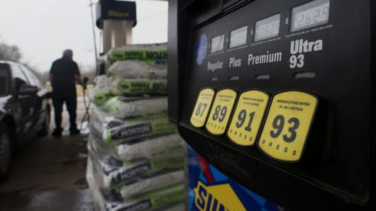 The price of fuel is seen on a pump as a customer fills a vehicle at a Sunoco Inc. gas station in Rockbridge, Ohio.
