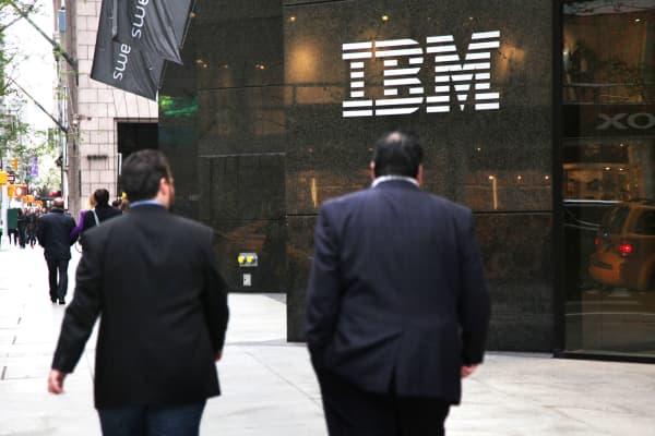 Pedestrians walk past the IBM building in New York.