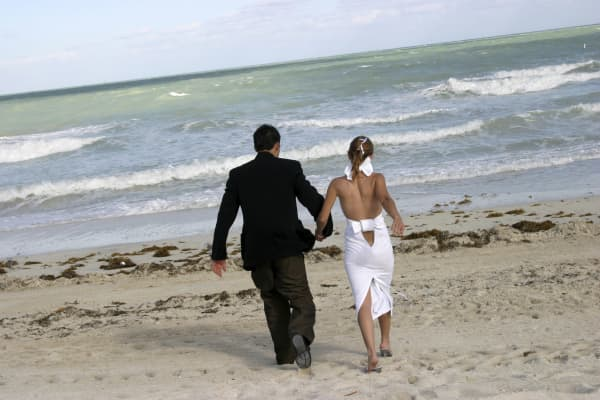 A couple is married in South Beack, Fla.