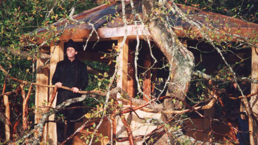Tree house architect Roderick Romero in front of the tree house he designed for Sting.
