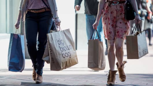 Pedestrians carry shopping bags in San Francisco.