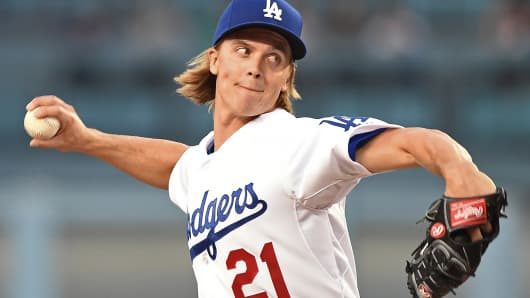 Los Angeles Dodgers' Zack Greinke pitches against the San Francisco Giants during the first inning of a game in Los Angeles.