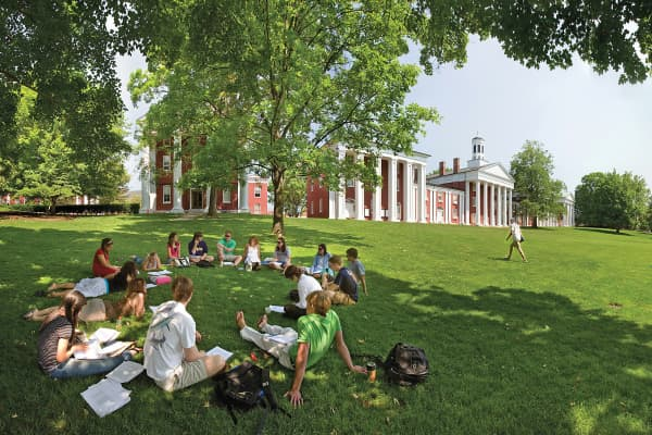 Students gather in the shade on the campus of Washington and Lee University in Lexington City, Va.