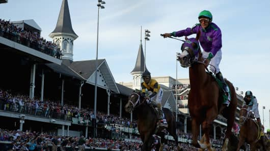 Jockey Victor Espinoza celebrates atop of California Chrome after winning the 140th running of the Kentucky Derby at Churchill Downs in 2014.
