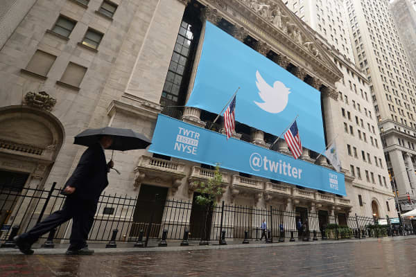 A banner with the Twitter logo is set on the front of the New York Stock Exchange, Nov. 7, 2013.