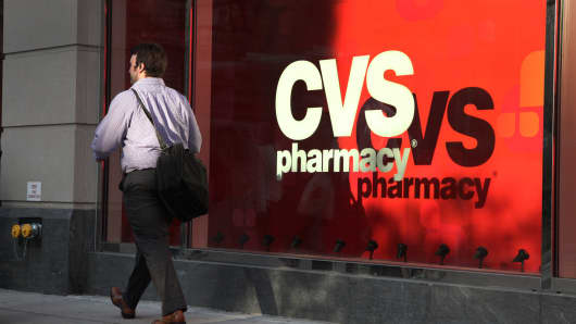 A pedestrian passes a CVS store in New York.