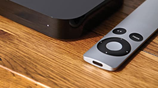 A file photo of an Apple TV and remote control
