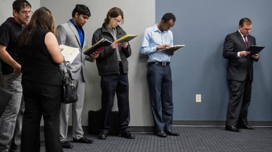 Job seekers wait in line to enter the Choice Career Fair in San Antonio, Texas.