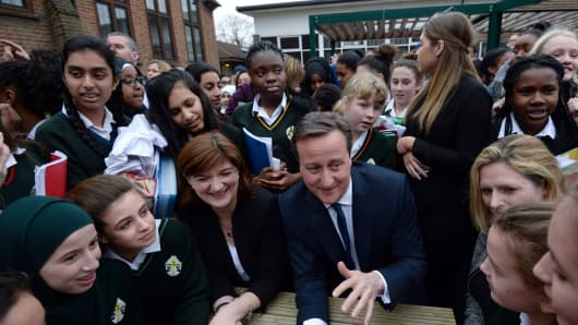 Prime Minister David Cameron and Education Secretary Nicky Morgan meet pupils during a visit to the Green School For Girls in London.