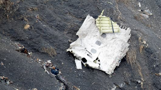 In this handout image supplied by the Ministere de l'Interieur (French Interior Ministry), search and rescue teams attend to the crash site of the Germanwings Airbus in the French Alps on March 25, 2015 near Seyne, France.