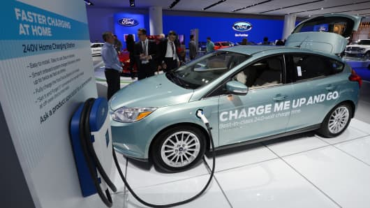 A Ford Focus electric concept car with a home charging unit on display at the 2013 North American International Auto Show in Detroit, Michigan, January 15, 2013.
