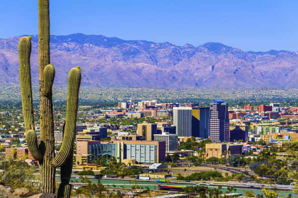 Tucson, Arizona skyline framed by cactus and mountains