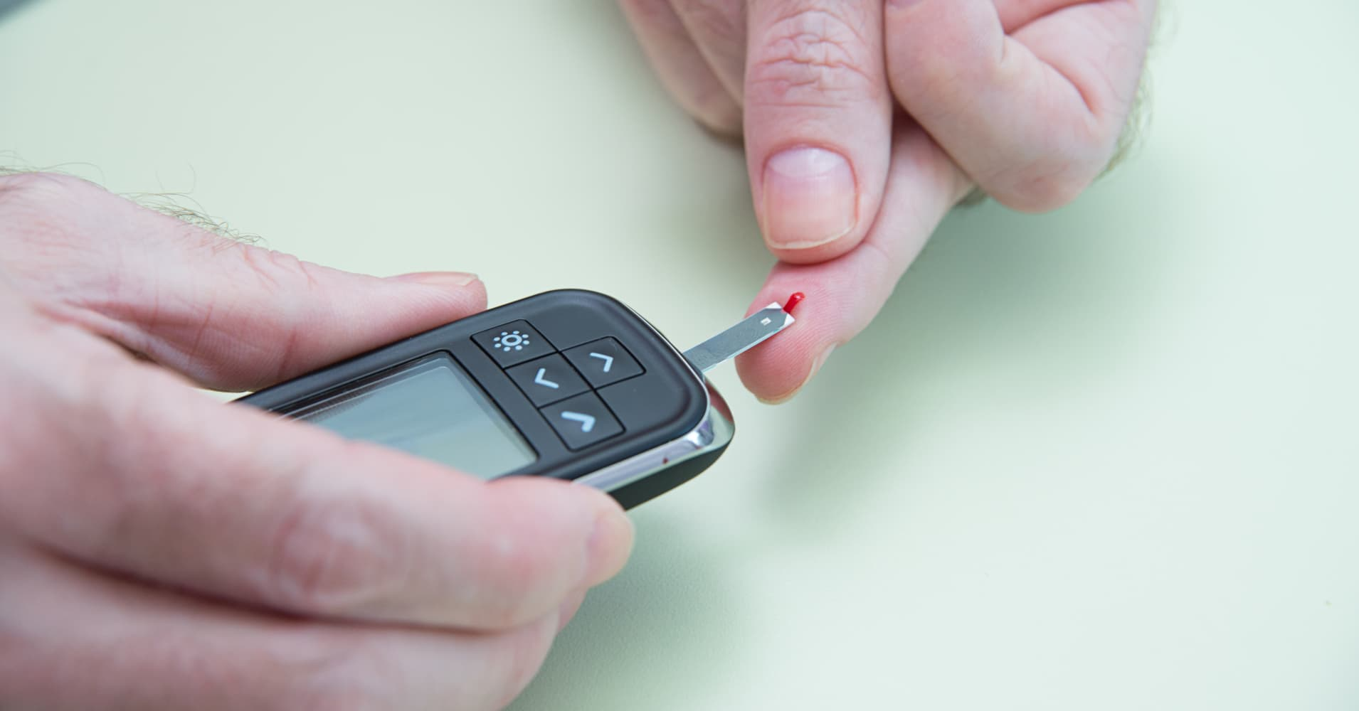 A man with diabetes takes a blood sugar level test.