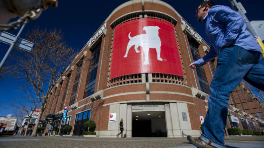 Pedestrians walk in front of the Zynga headquarters in San Francisco.