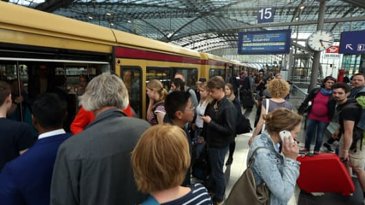 German passengers wait to board their train