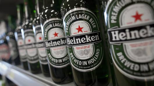 Bottles of Heineken NV lager are displayed for sale in the 'beers, wines & spirits' aisle of a supermarket in Slough, U.K.