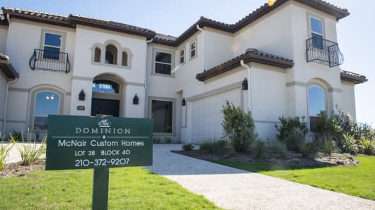 A new home for sale stands in the Andalucia neighborhood of The Dominion gated community in San Antonio, Texas.