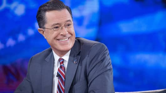 "Stephen Colbert smiles while taping the ""The Colbert Report"" with President Barack Obama, not pictured, in Lisner Auditorium at George Washington University in Washington, Dec. 8, 2014."