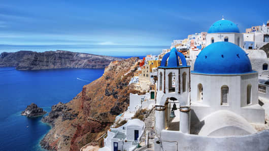 Blue-domed church in Santorini, Greece