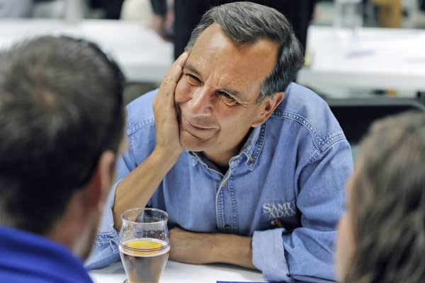 Samuel Adams brewer and founder Jim Koch listens to small business owners during a speed coaching session at the Boston Beer Company small business loan and business-coaching program in Denver.