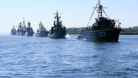 Baltic Fleet vessels in ceremonial formation at a rehearsal of the navy parade to mark the 70th anniversary of WWII victory.