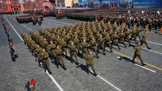 : Russian army soldiers in Soviet uniform of WWII march along Red Square during the final rehearsal of the Victory Day parade ahead of celebrations to mark the 70th anniversary of the 1945 victory over Nazi Germany.