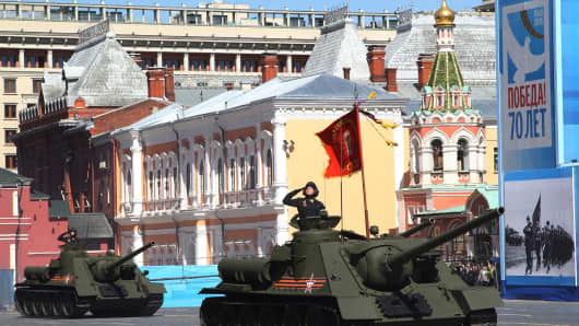 Russian army tanks roll along Red Square during the final rehearsal of the Victory Day parade