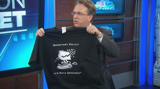 "John Williams holds a T-shirt on CNBC's ""Squawk On the Street,"" Monday, May 11, 2015."