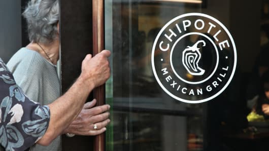 Customers enter a Chipotle restaurant in New York