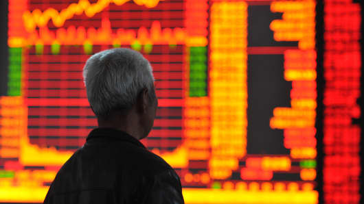 Investors observe stock prices in Huaibei, China.