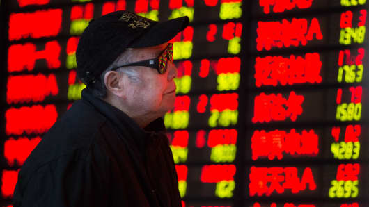 An investor observes stock prices in Huaibei, China.