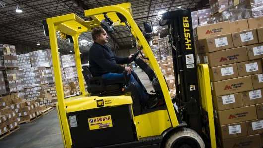 An employee operates a forklift at the distribution center of Oregon Freeze Dry.