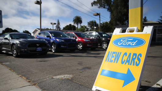 New Ford cars are displayed on the sales lot at Veracom Ford in Burlingame, California.