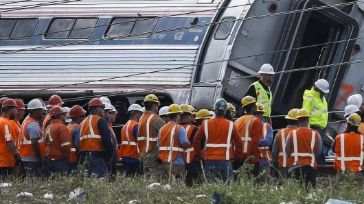 Officials meet at the site of a derailed Amtrak train in Philadelphia, May 13, 2015.