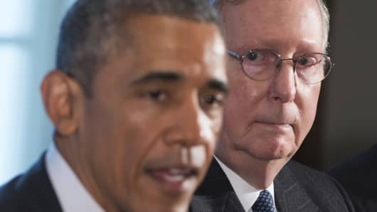 President Barack Obama speaks alongside Senate Majority Leader Mitch McConnell (R), Republican of Kentucky.