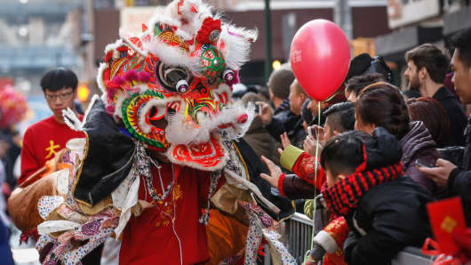 People participate in the Chinese Lunar New Year Parade in Manhattan's Chinatown, New York on February 22, 2015.