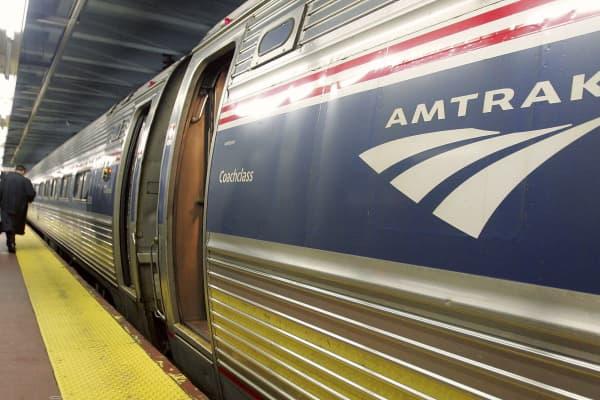 A man walks to board an Amtrak train in Penn Station in New York City.