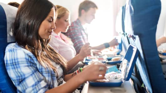 Airline passenger eating meal