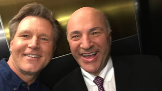 Allan Shoemake and Kevin O'Leary snap a selfie using the LuMee light-up cell phone case