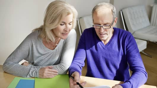 Older couple looking at paperwork