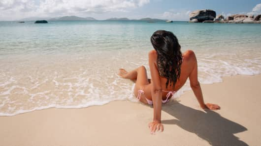 Woman sunbathing beach