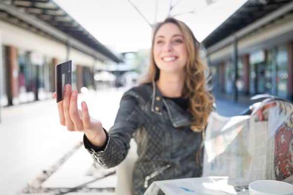 Young woman student millennial credit card